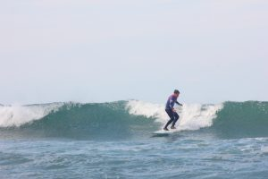 henry starting to turn on a lovely left-hander intermediate surf camp north cornwall mawgan porth