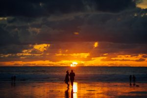 alex rawson photograph of sunset on the beach looking at the surf at watergate bay after newquay boardmasters music festival