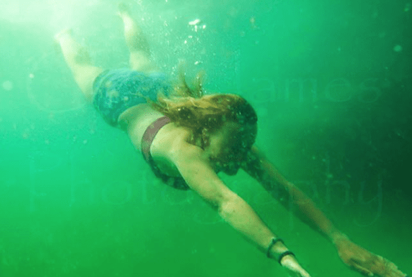 clear green water in north cornwall, sea swimming in newquay in cold water without a wetsuit, breath hold surf training