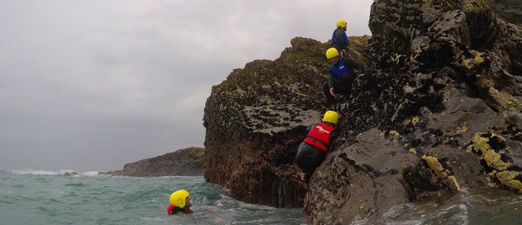 wild water swimming in north cornwall, coasteering and rock climbing in newquay