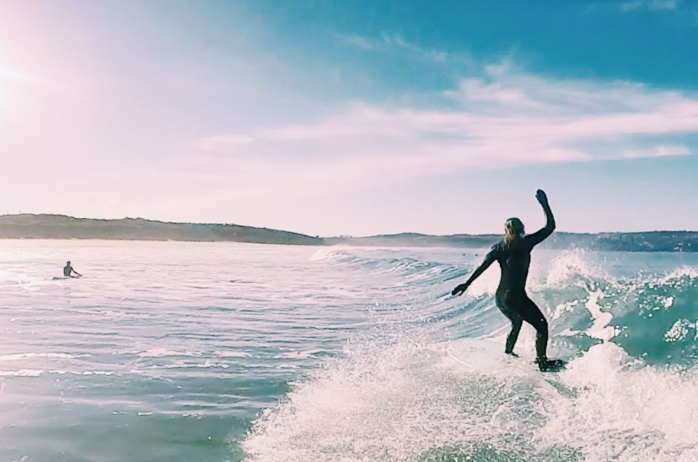 Kirsty surfing - I learnt to surf with Kingsurf and it changed my life!